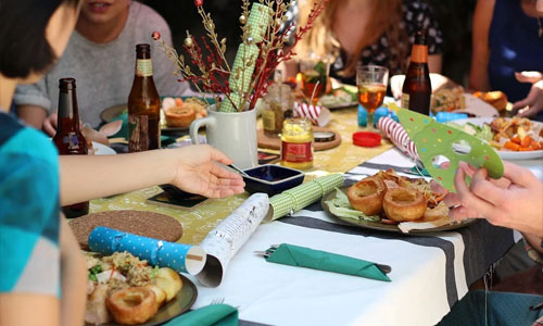 5 Tips for Hosting A Pokies Themed Party friends eating - 5 Tips for Hosting A Pokies Themed Party